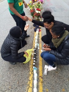Students Light Candles at the Mike Brown Memorial